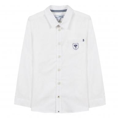 photographe-naissance-paris-chemise-blanche-ecusson-tc-junior